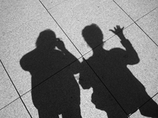 shadows of meredith and barb on the sidewalk