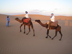 Carol & Barb at Caroll on camels in Morocco